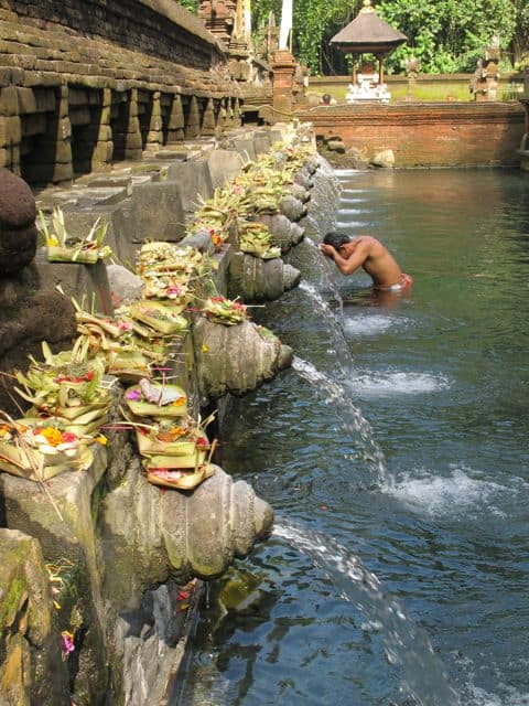 Bathing ritual at the Sacred Water temple in Bali.