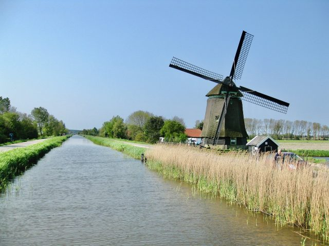 windmill-canal-countryside-holland-photo