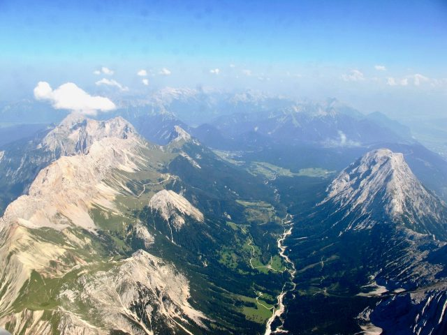 plane-window-view-tyrol-alps