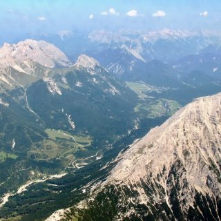 tyrol-alps-plane-window-view-photo