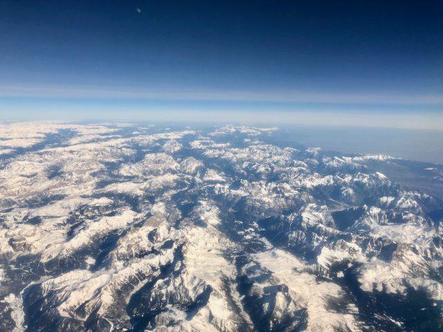 plane-window-view-european-alps-photo