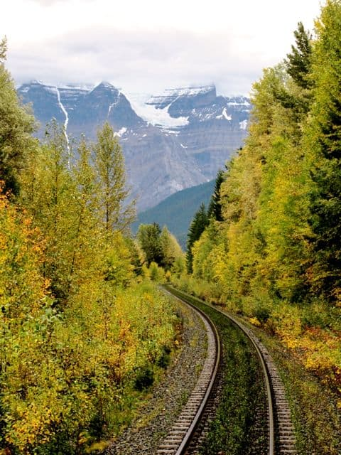 winding-train-tracks-rockies-photo