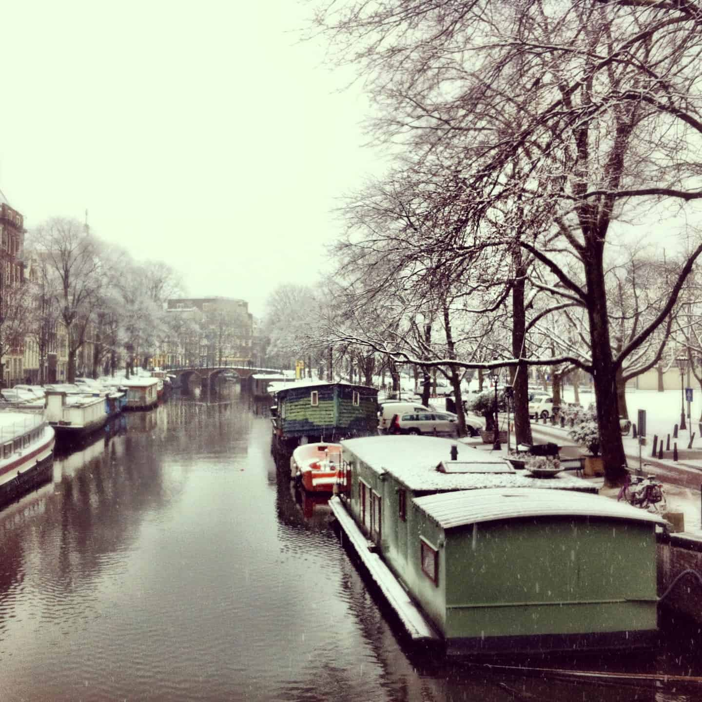 Velvet Moments: travel photo – snowy canal in Amsterdam