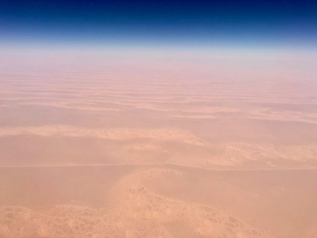 plane-window-view-sahara-desert-photo