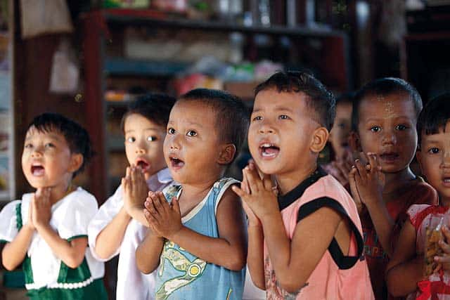Children singing at a school in Myanmar.