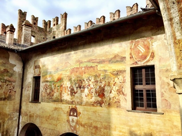 malpaga-castle-courtyard-frescoes-photo