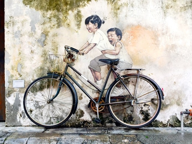 boy-girl-bicycle-street-art-photo