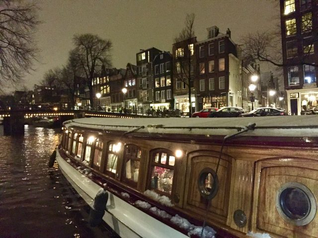 canal-boat-amsterdam-evening-photo