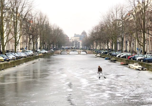 lone-skater-amsterdam-frozen-canal-photo