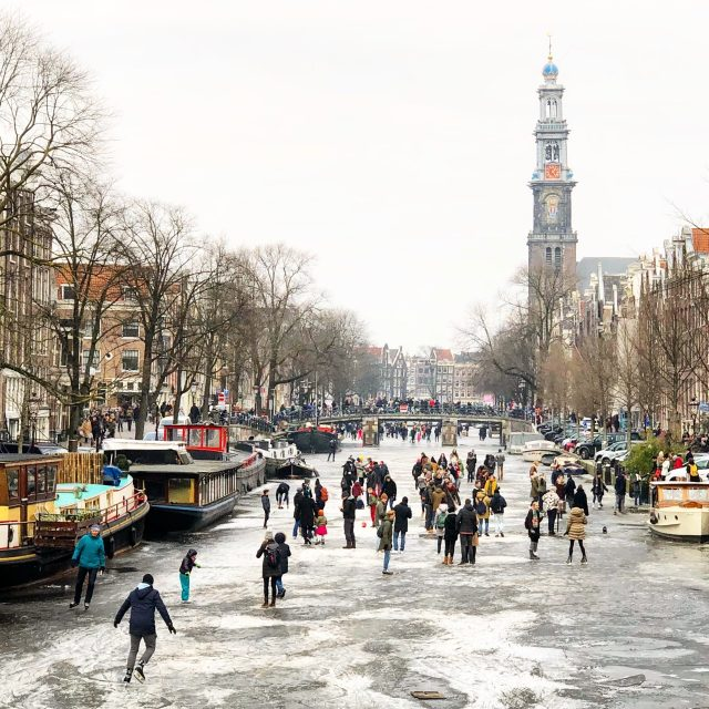 ice-skating-frozen-canal-amsterdam-photo