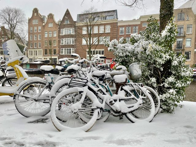 Bicycles snow in Amsterdam